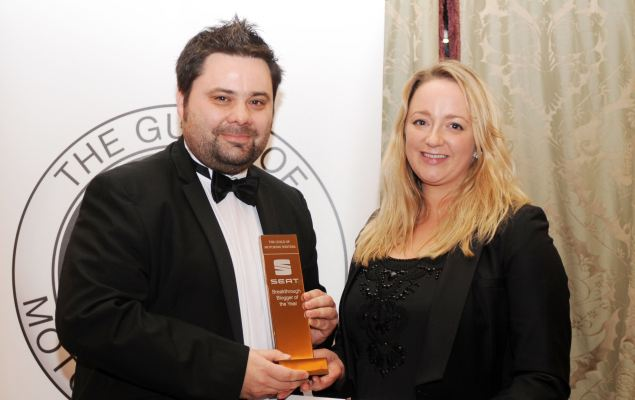 Keith WR Jones receiving the Guild of Motoring Writers Breakthrough Blogger Award from SEAT's Juliet Carrington