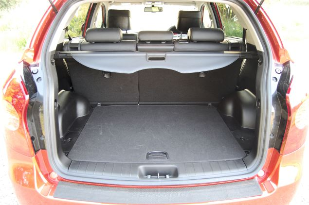 Spacious boot but high lip and a lot of uncarpeted surfacing in the Korando's boot.