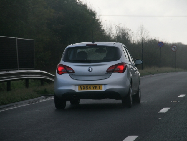New 2015 Vauxhall Opel Corsa UK launch first drive impressions road test review 1 litre 1.4 ECOTEC handling Fiesta interior quality Polo - photo - silver on the road