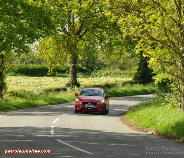 All-new 2015 Mazda2 1.5 90PS SE-L Nav full road test review evaluation report, freelance motoring blogger automotive journalist Oliver Hammond, wallpaper gallery photo - front cornering