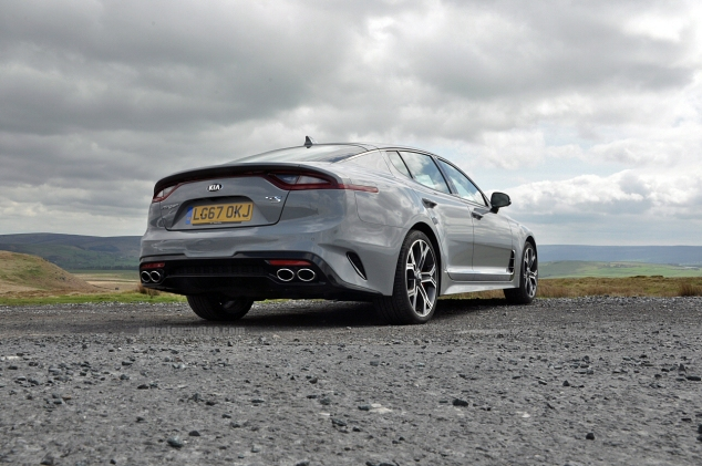 Kia Stinger GTS Oliver Hammond review blogger wallpaper photo - rear tailpipes static Maserati